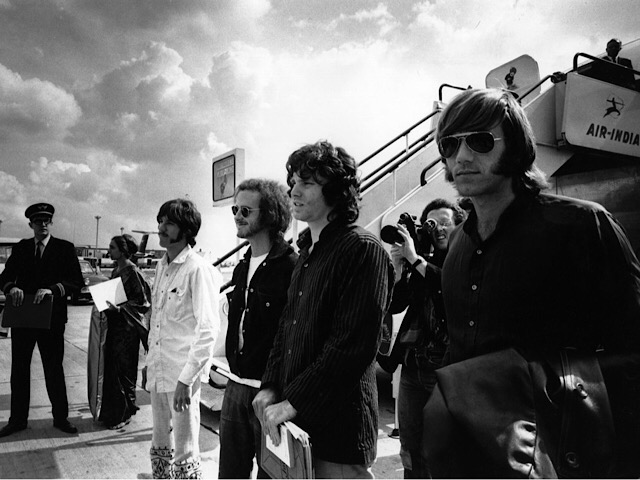 The Doors—from left to right: John Densmore (drummer), Robby Krieger (guitarist), Jim Morrison (singer), and Ray Manzarek (keyboardist)—arrive at Heathrow Airport in London, England on September 3, 1968. Photo by Granada Television.