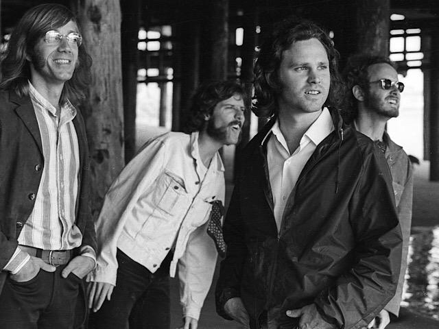 The Doors were photographed under the pier in Venice, CA. Photo by Henry Diltz.