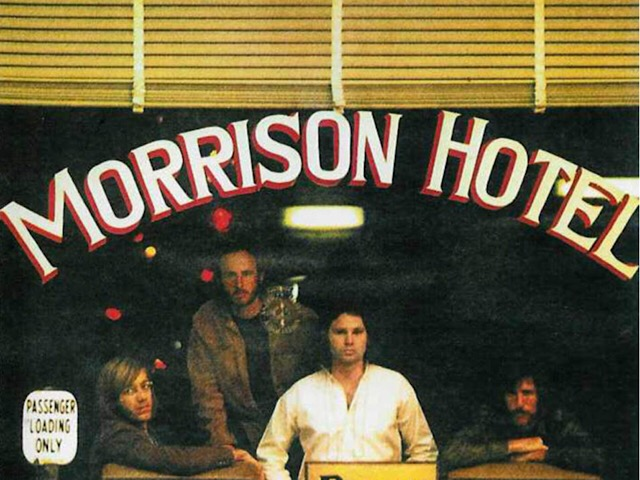American rock group The Doors, from left to right: Ray Manzarek (organist), Robby Krieger (guitarist), Jim Morrison (lead singer), and John Densmore (drummer), posed for the MORRISON HOTEL album cover at Morrison Hotel in Los Angeles, California on December 17, 1969. Photo by Henry Diltz.