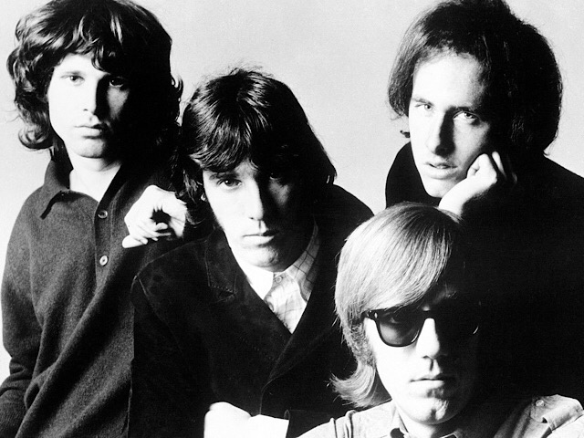 American rock group The Doors, from left to right: Jim Morrison (singer), John Densmore (drummer), Ray Manzarek (organist), and Robby Krieger (guitarist), posed for Elektra Records publicity photos in New York City, New York in November 1966. Photo by Joel Brodsky.