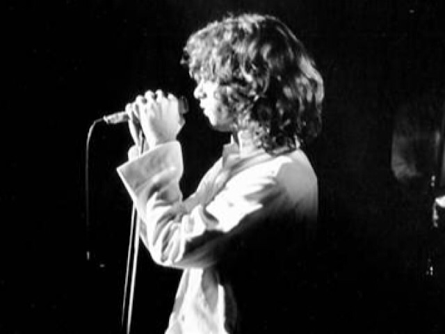 Singer Jim Morrison, seen here in 1970, died in 1971. But like Elvis, he lives on in fiction and rumor. Getty Images file.