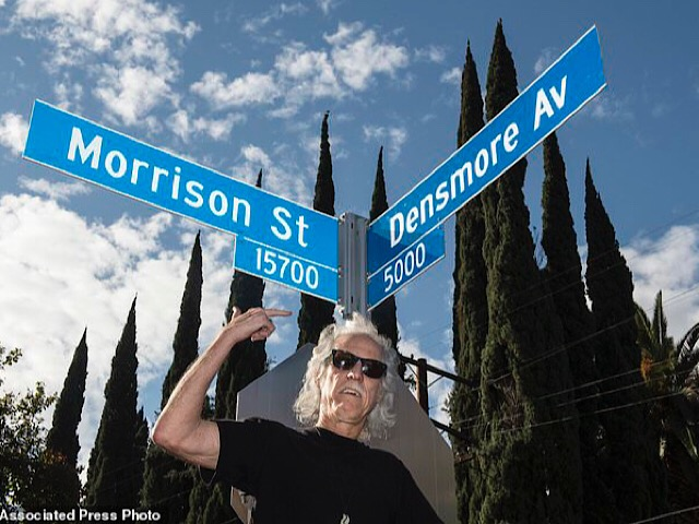 It's a sign: John Desmore unveiled a pair of street signs in Encino on Thursday that connected himself to the Doors bandmate Jim Morrison, with the intersection reading Morrison Street and Densmore Avenue