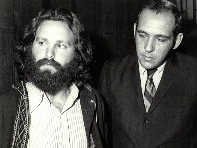 In this Oct. 31, 1970 photo, Jim Morrison, left, appears with his attorney in the courtroom after Morrison was sentenced to six months in jail and fined $500 on conviction of profanity in public and indecent exposure at a 1969 show in Miami. Morrison was allowed out on $50,000 bond. A month and a half later, he performed his last show with The Doors, in New Orleans.(Times-Picayune file photo)