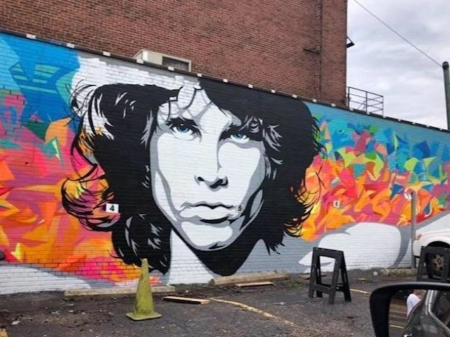 This Jim Morrison mural is on the side of Frontimo's Downtown at 315 Cleveland Ave. NW