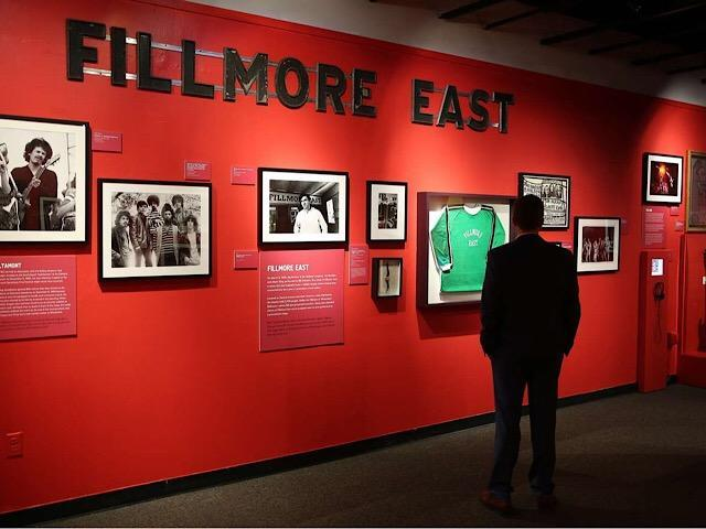 A photograph of The Doors lead singer Jim Morrison and a Doors, Joshua Light Show, and Ars Nova concert poster from the Fillmore East concert venue, New York City, 1968, are part of the exhibition. (Scott Keeler, Tampa Bay Times)