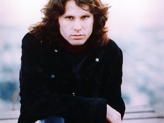 Jim Morrison, lead singer of The Doors, posed at Houdini Estate in the Hollywood Hills, Los Angeles, California in 1968. Photo by Paul Ferrara.