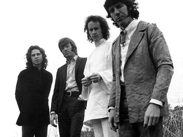 American rock group The Doors, from left to right: Jim Morrison (singer), Ray Manzarek (organist), Robby Krieger (guitarist), and John Densmore (drummer), posed for publicity photos for the album WAITING FOR THE SUN in the Santa Monica Mountains in Santa Monica, California in spring 1968. Photo by Paul Ferrara.