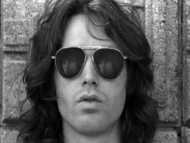 Jim Morrison, lead singer of The Doors, posed in Griffith Park Observatory in Los Angeles, California in 1968. Photo by Paul Ferrara.